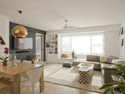 Living and dining room in light bright colors with large window