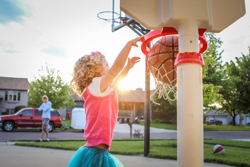 A young girl playing basketball