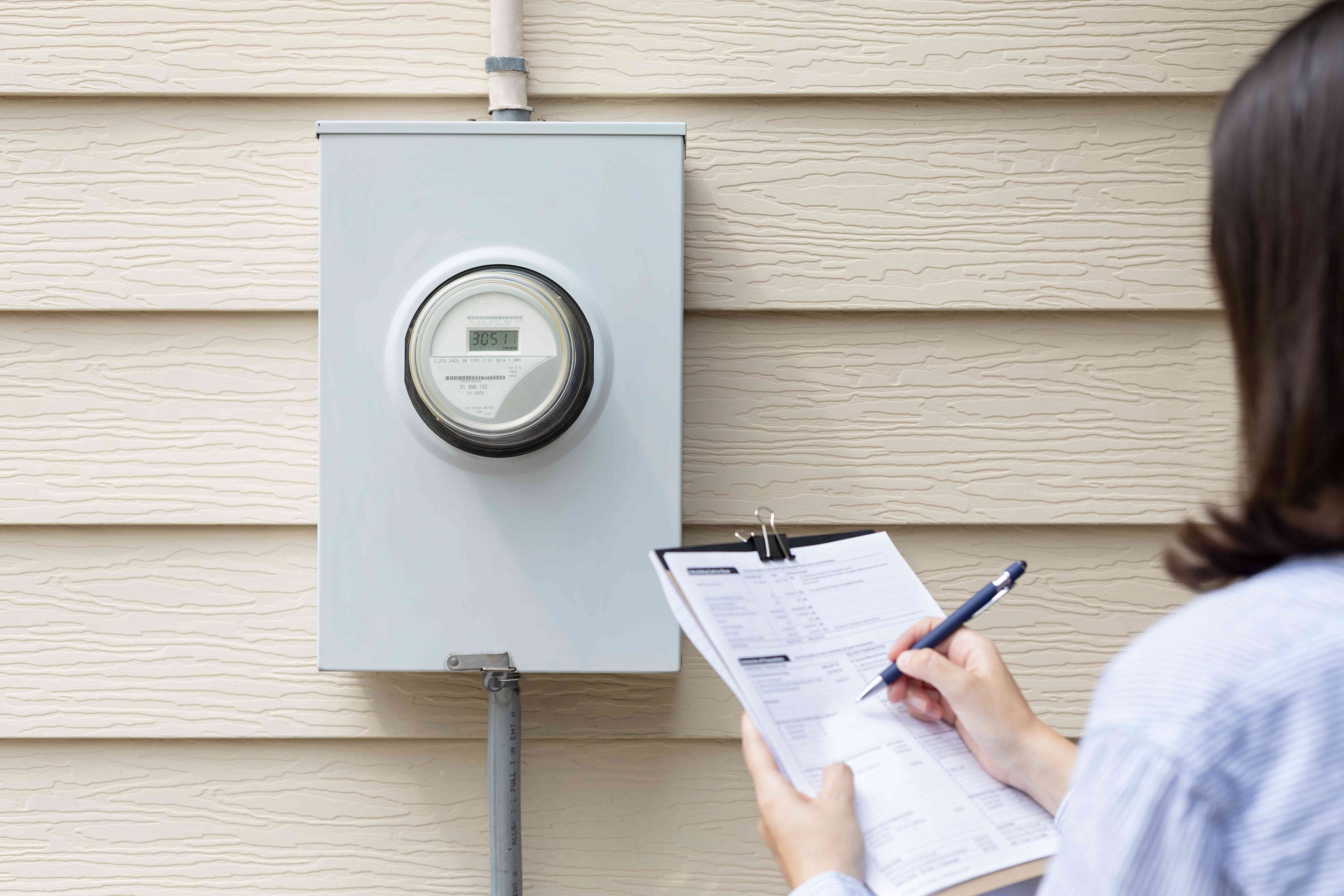 Outdoor energy meter being audited to lower electricity bill