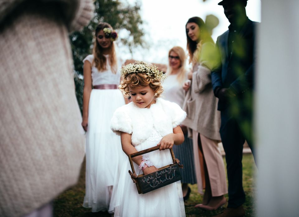 Flower girl walks down aisle