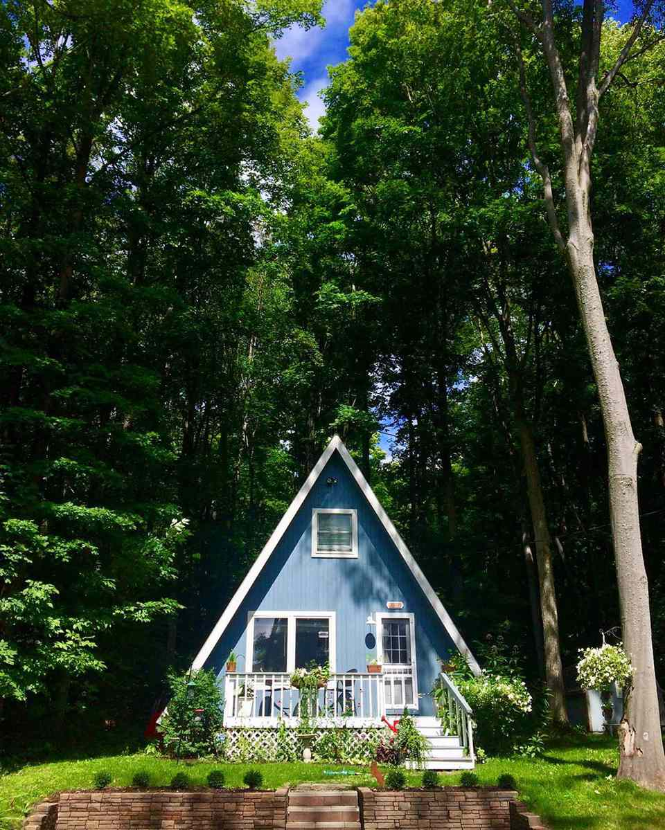 Blue a-frame house with white molding