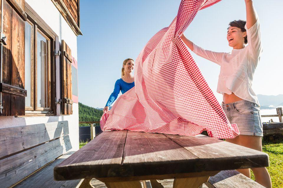 Two women preparing table, Tyrol, Austria