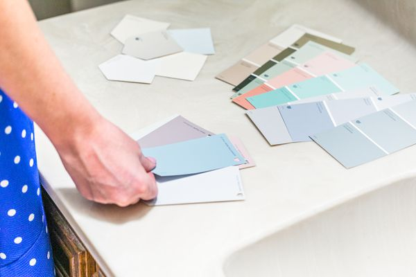person looking at paint swatches