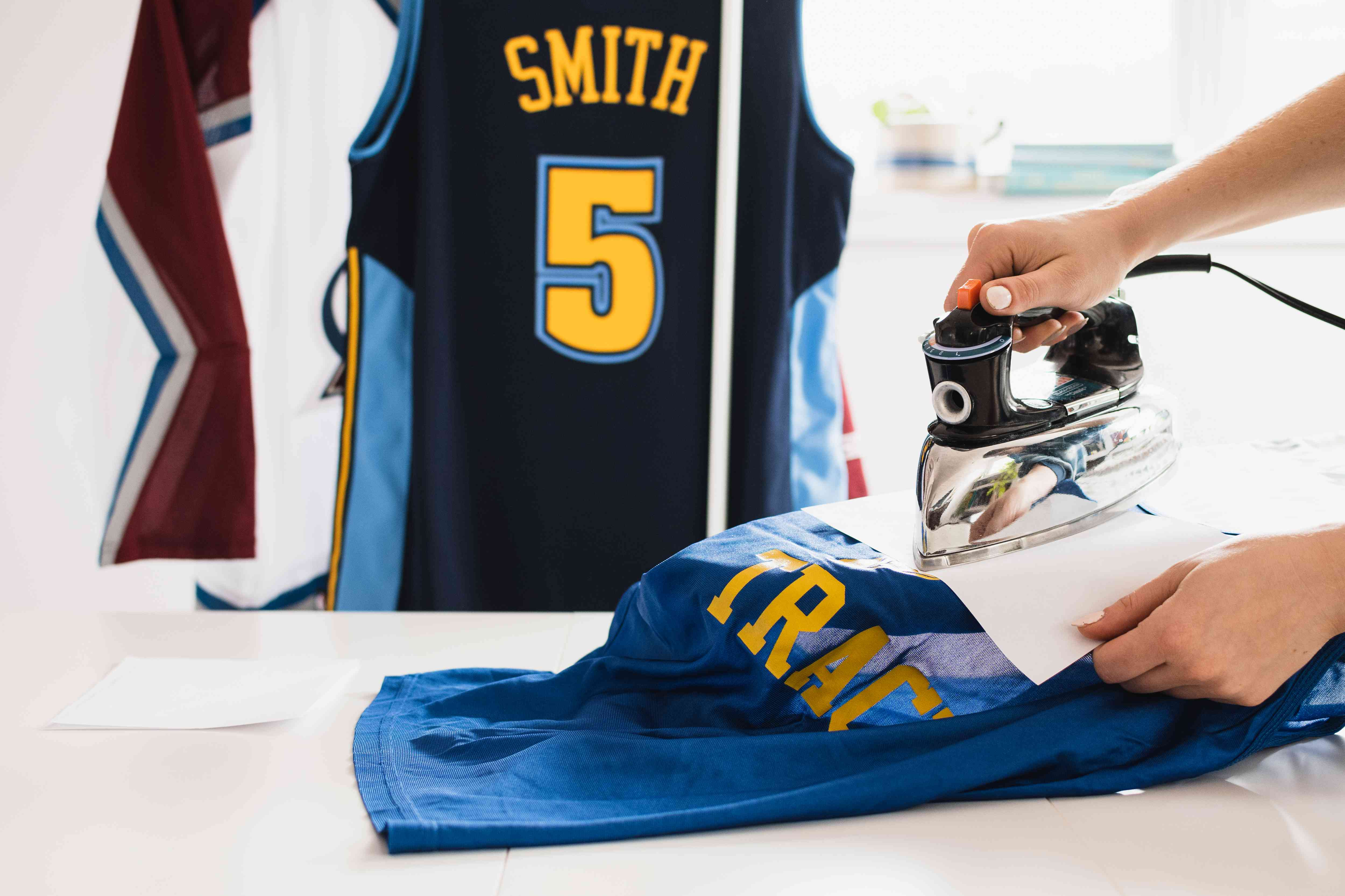 Repairing lettering of team jersey with iron and decal paper