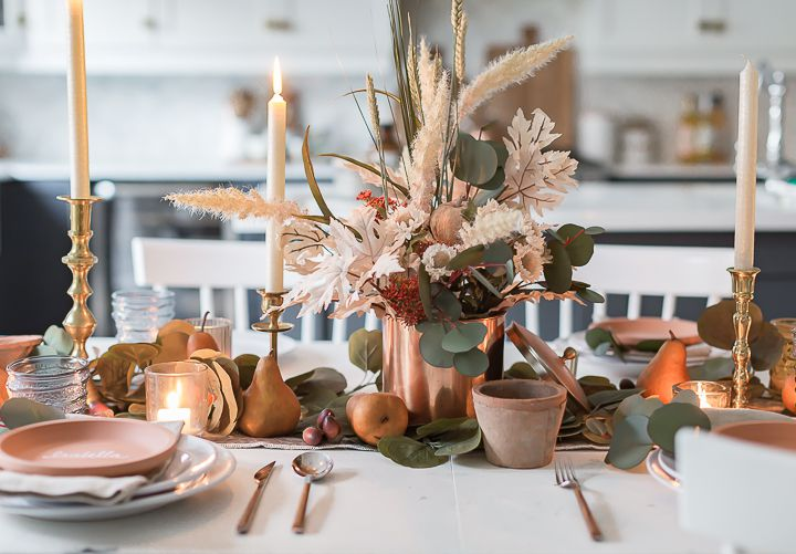 Thanksgiving table with copper, clay and dried flowers.