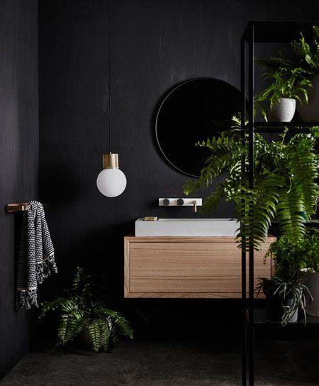 Black Bathroom With Green Plants