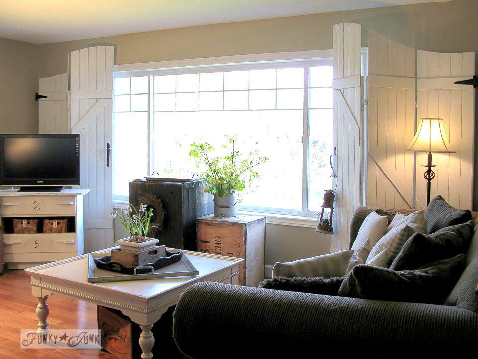 A living room with white window screens