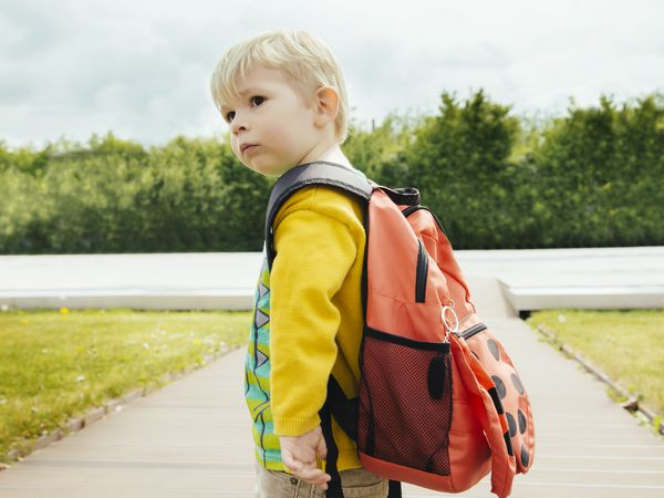 Toddler with backpack going to leave