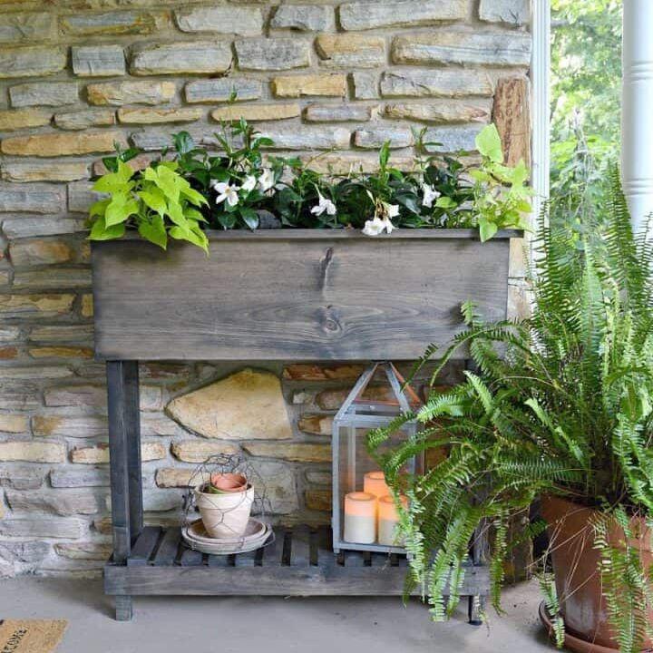 A wooden planter box on a porch