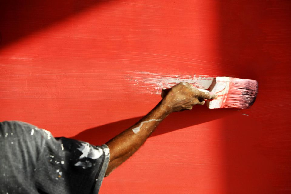 Man's Hand Painting Wall Red