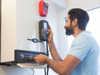 man working with space heater technology