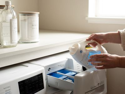 person using a high-efficiency washer