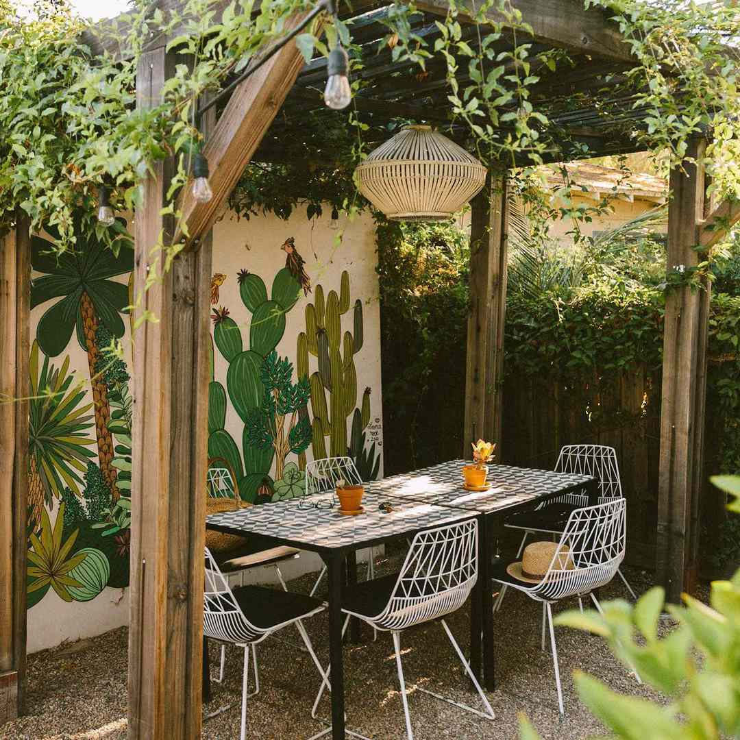A cactus mural in an outdoor dining area