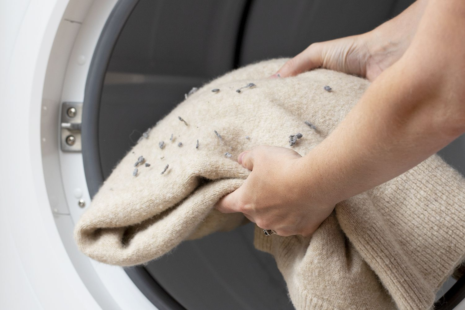 lint on a sweater coming out of the dryer