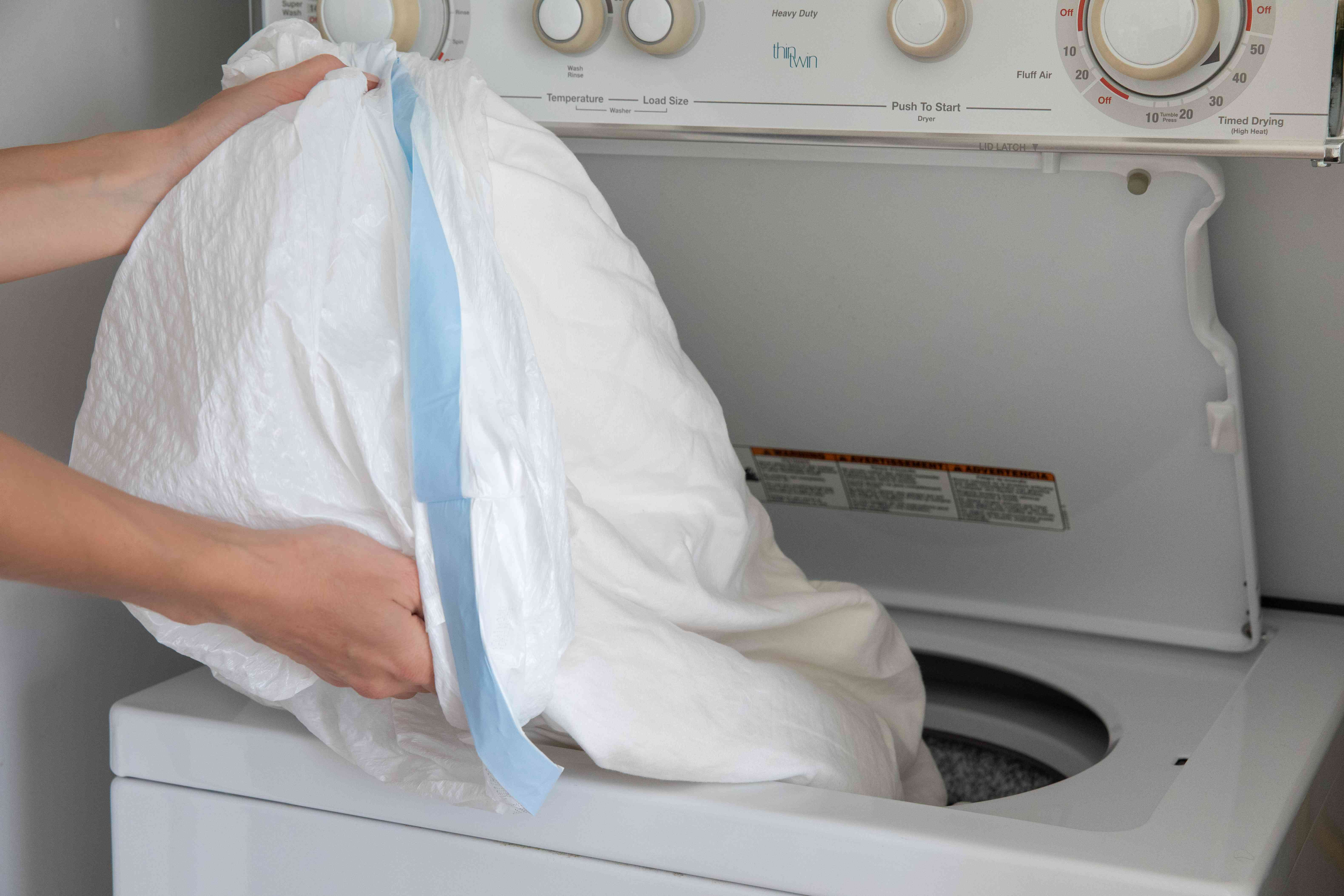 Bug infested clothes in plastic trash bag spilled into washing machine