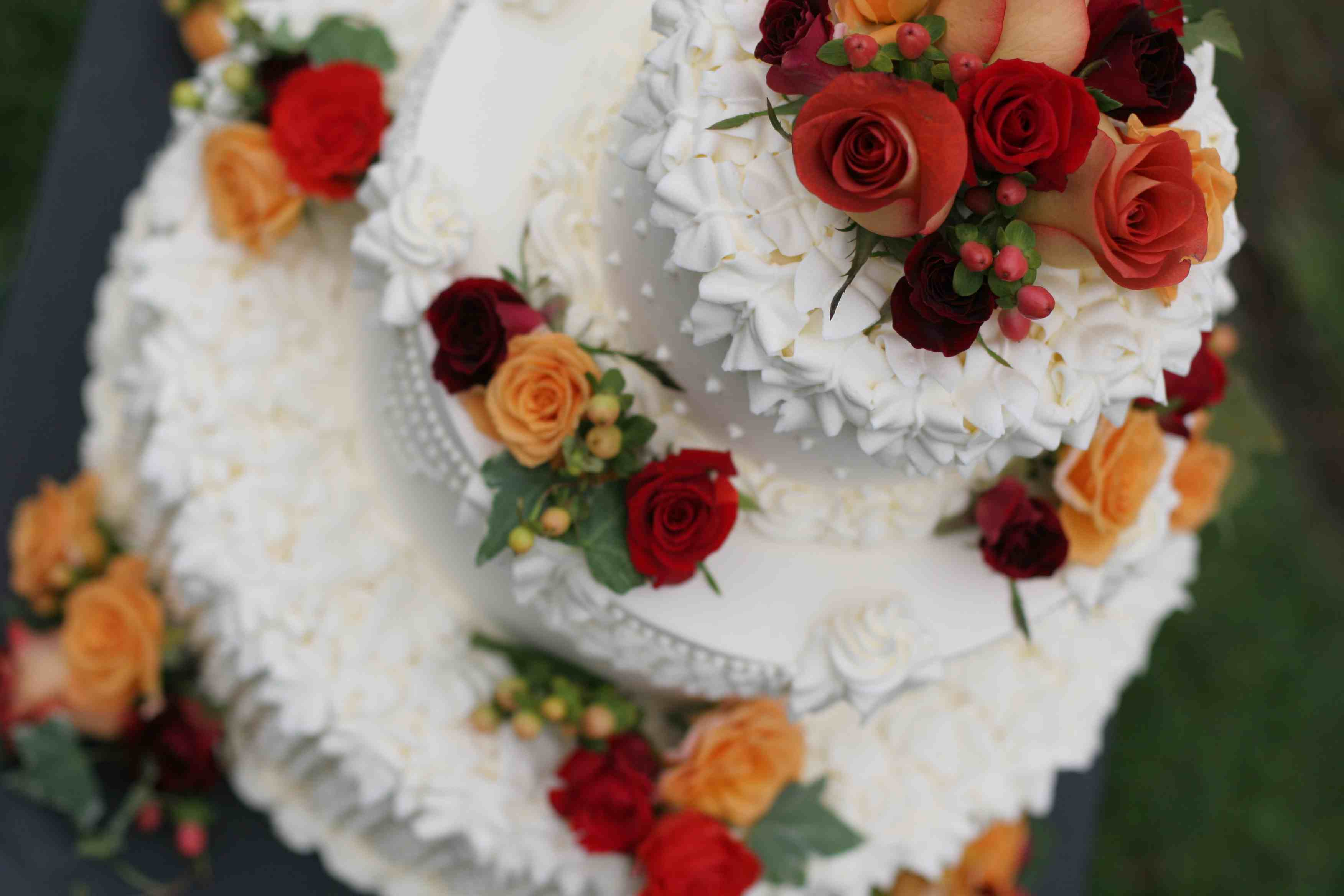 Wedding Cake with Red and Orange Roses
