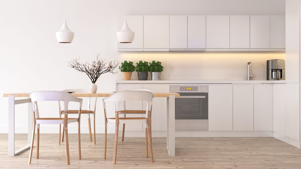 pendant and recessed lighting in a Scandinavian style kitchen