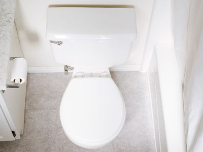 White ceramic toilet in bathroom seen from above