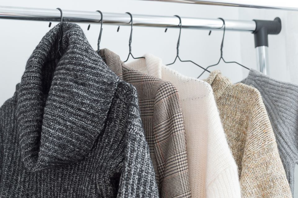 sweaters hanging on a rack
