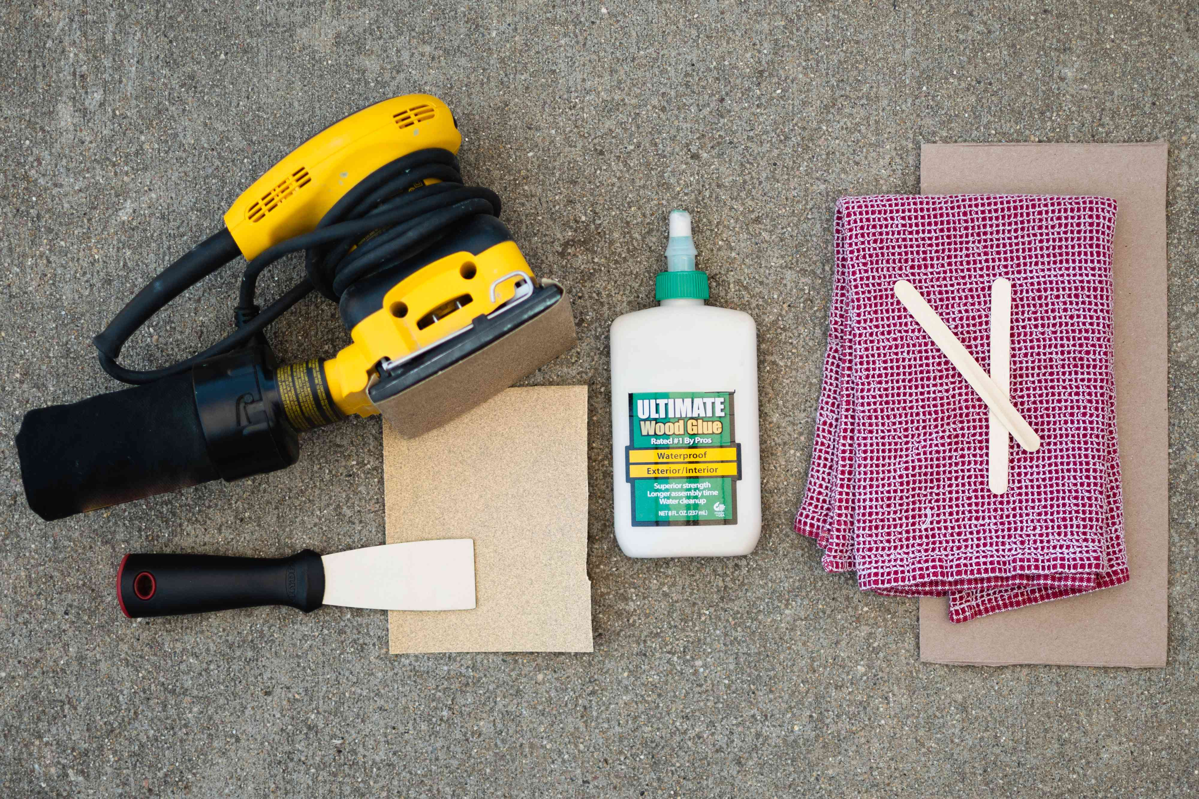 Materials and tools to make homemade wood filler