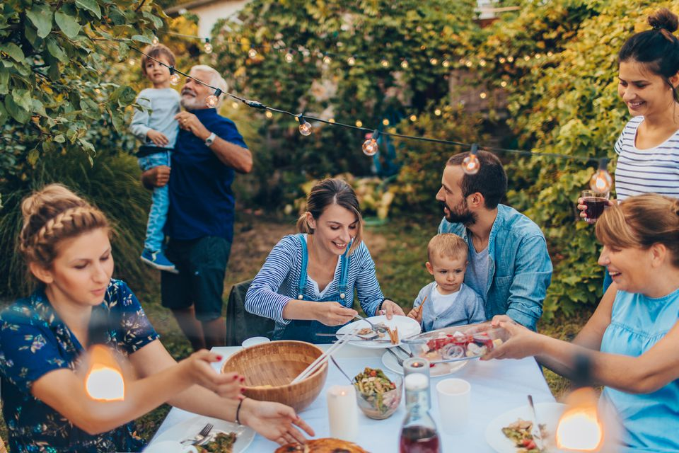 A family eating outdoors.