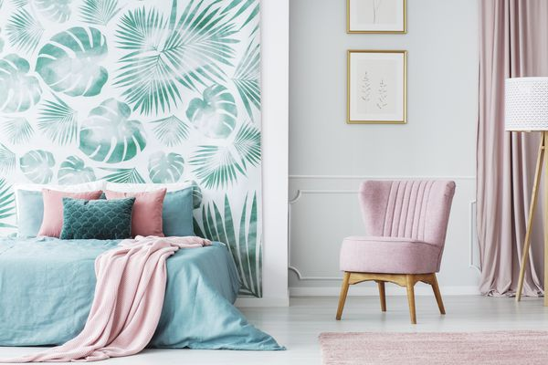 Green and pink bedroom with pink chair