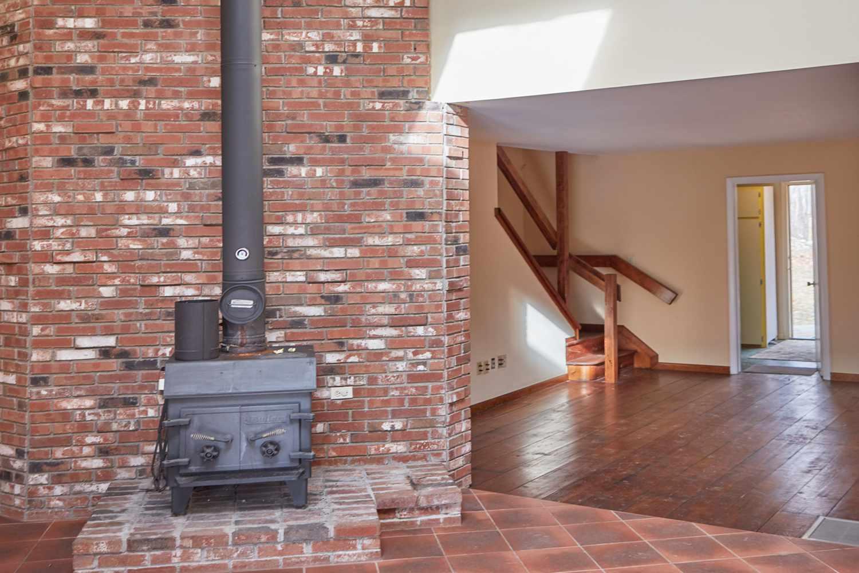 Masonry wall behind fire stove as load bearing wall