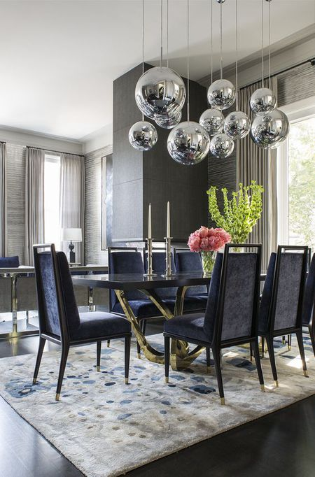 Gray Dining Room With Modern Lighting And Rug