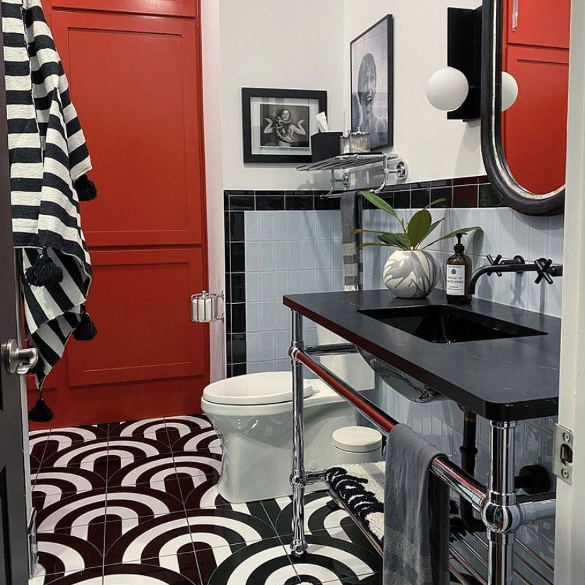 black, white, and red bathroom