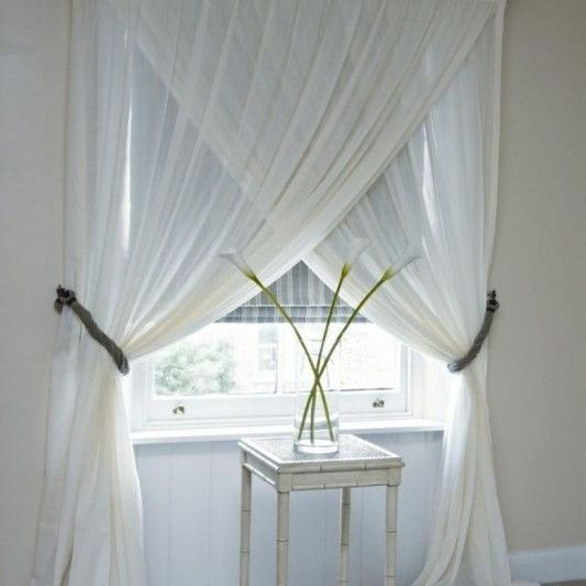 crossed white curtains