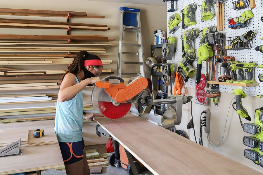 Jen Woodhouse with Miter saw cutting wood in workshop