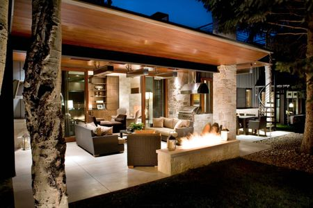 covered patio designs outdoor living room with stone and wood - 50 Stylish Covered Patio Ideas