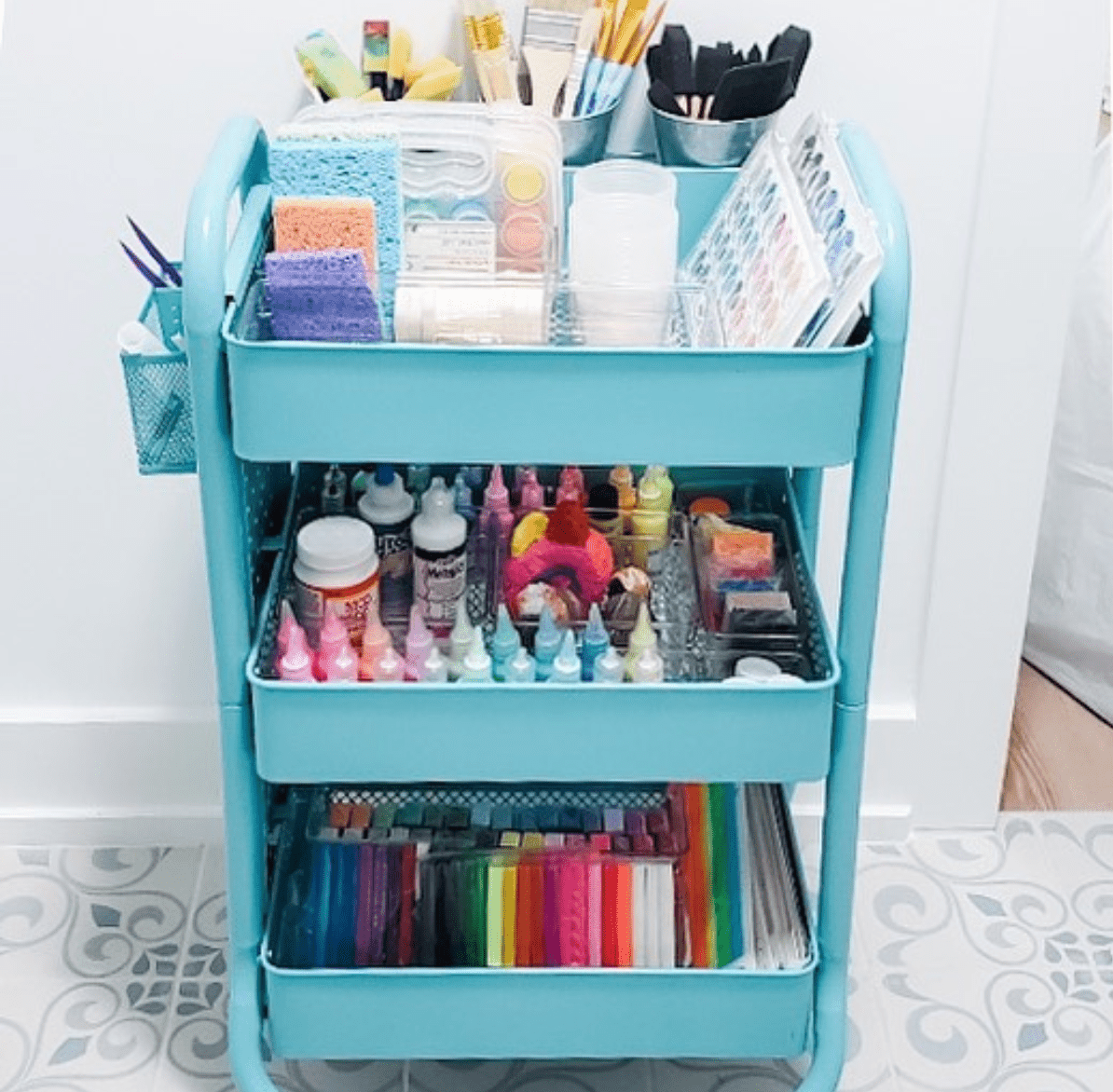 a rolling cart used for storing craft supplies
