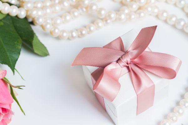Box with pink ribbon