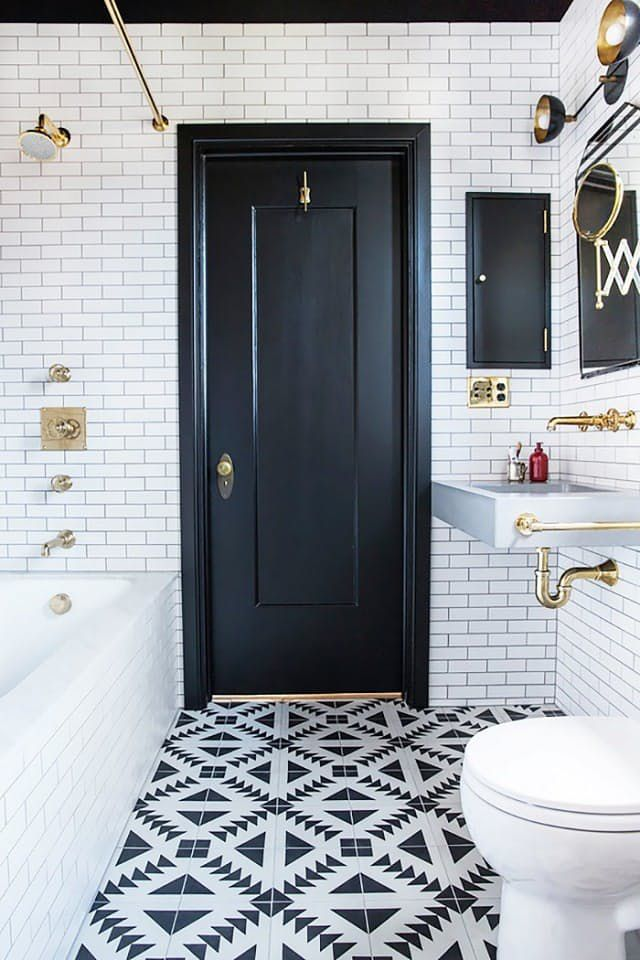 bathroom with small black and white tiles