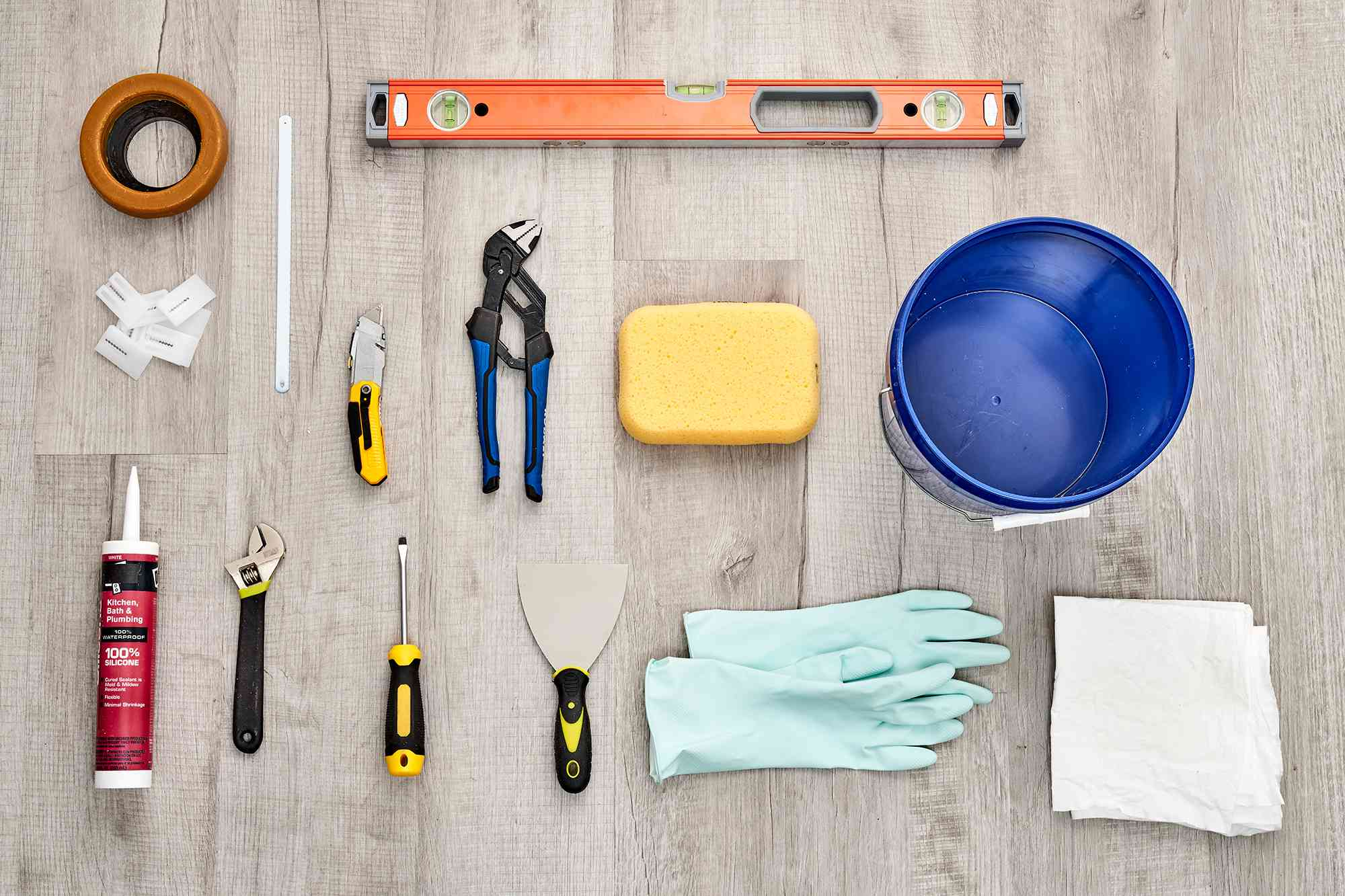 Materials and tools to replace a toilet