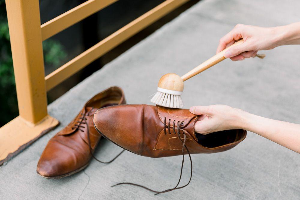 Someone brushing leather shoes