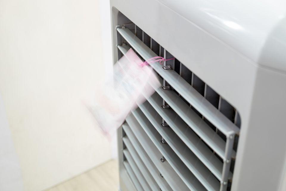 Evaporative air cooler front running blown