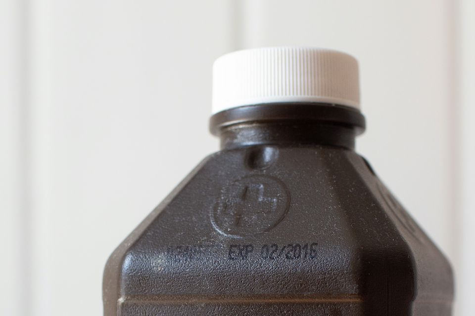 closeup of an expiration date on a bottle of peroxide