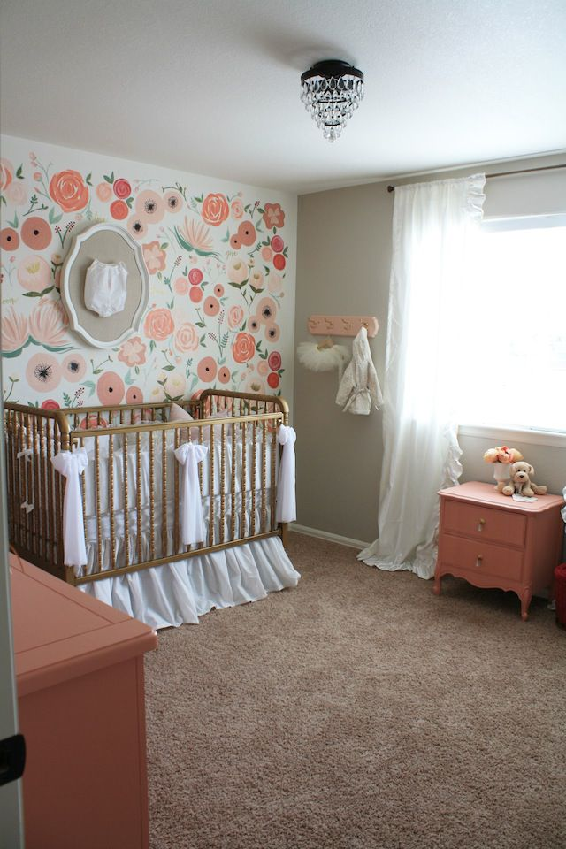 Vintage floral nursery with hand-painted mural