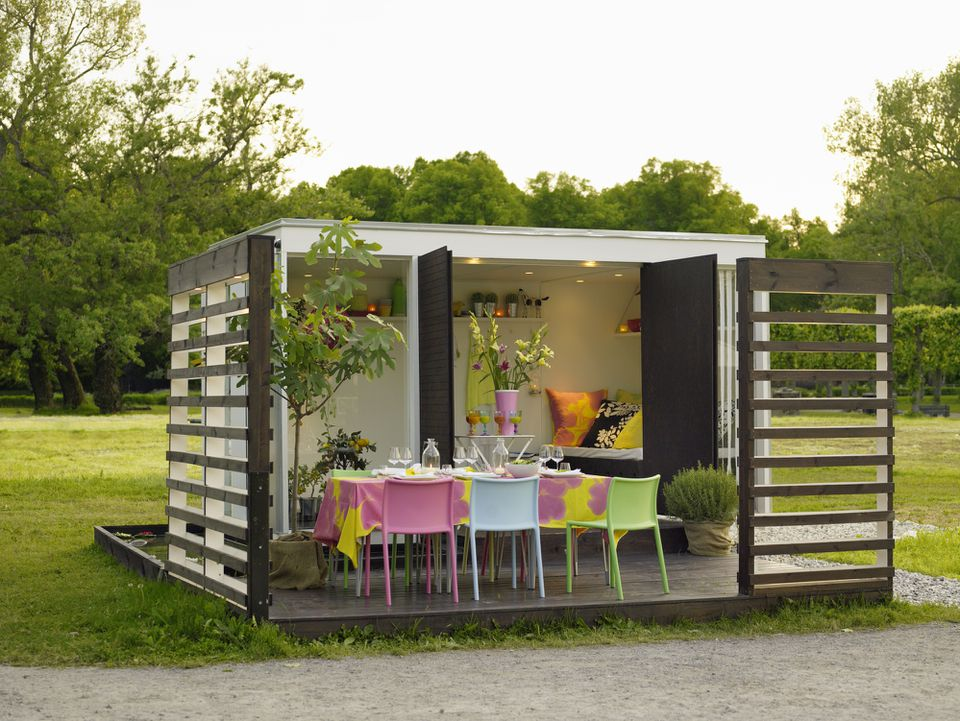 A she shed with patio and table
