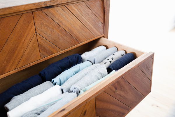 neatly folded items in a drawer