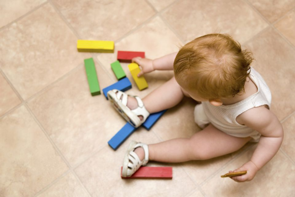 Linoleum playroom flooring with toddler playing