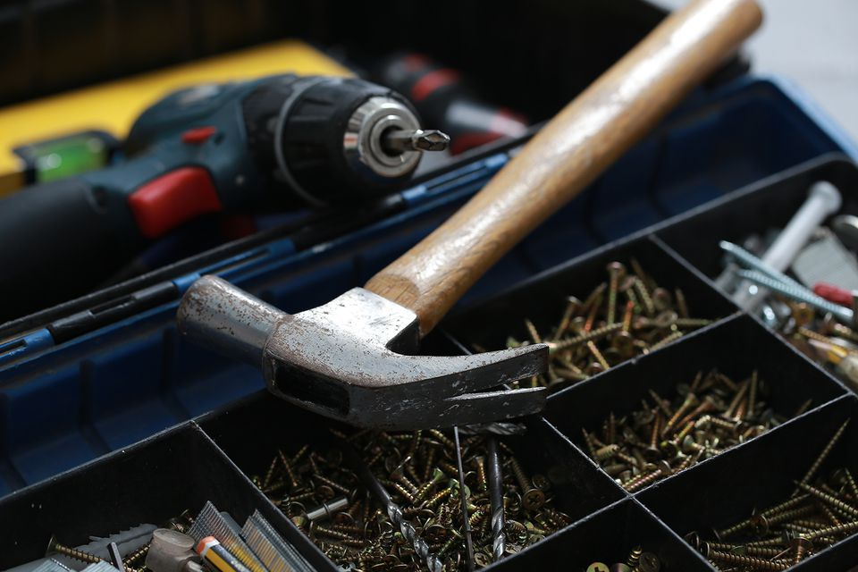 Close-Up Of Work Tools On Box