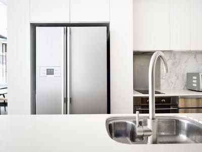 Kitchen in a modern luxury condo - stock photo