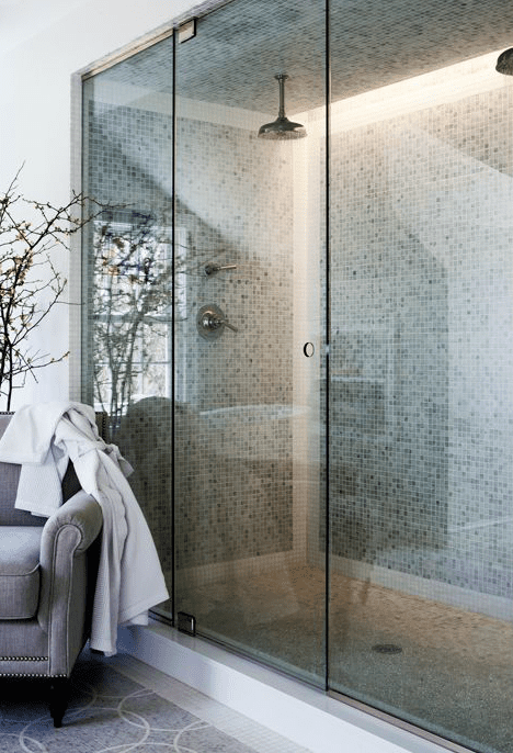 A double shower with mosaic tile