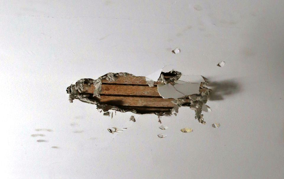 Broken drywall on a interior ceiling