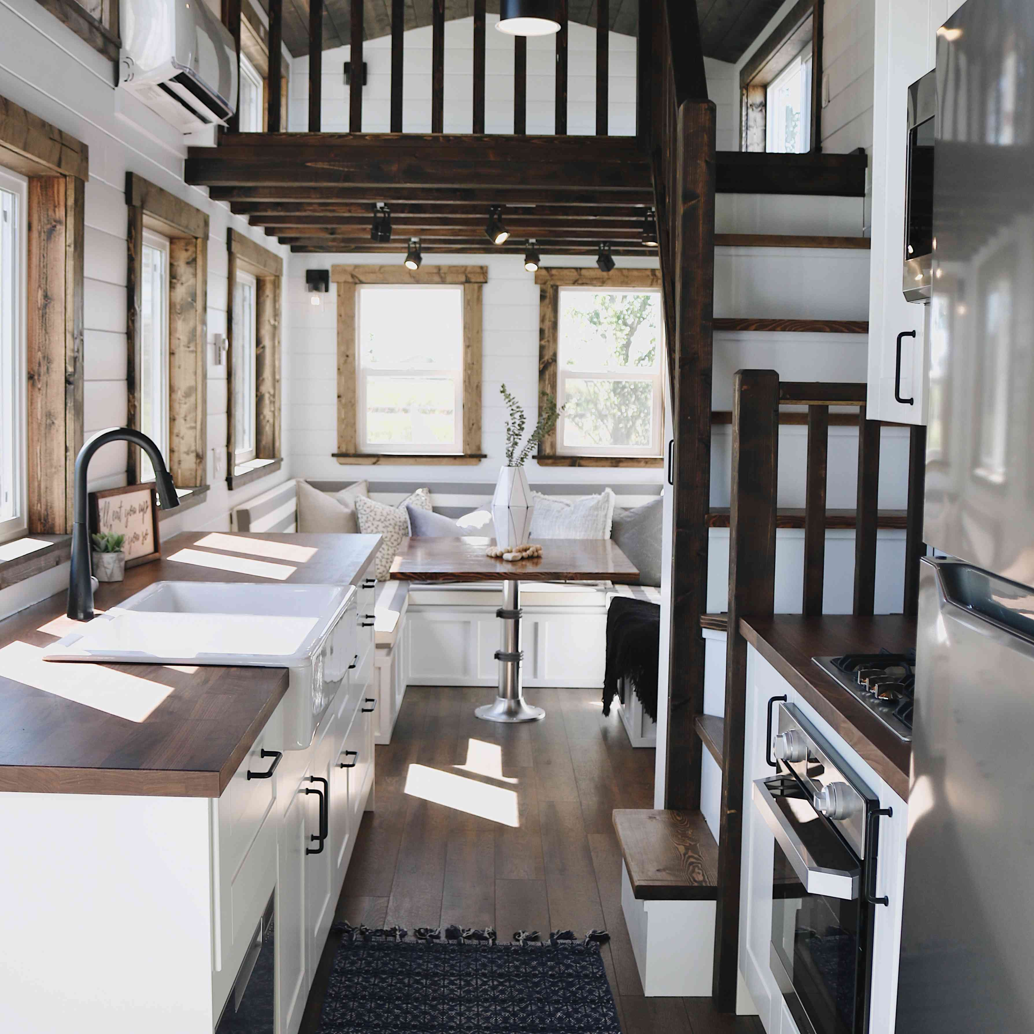 tiny house kitchen with dark wood accents