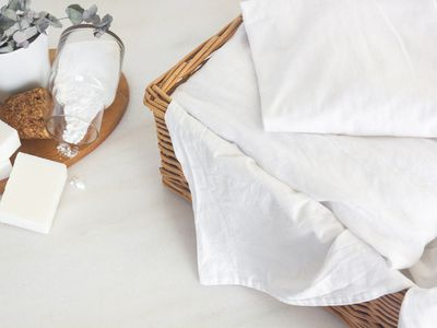 laundry basket of white linens