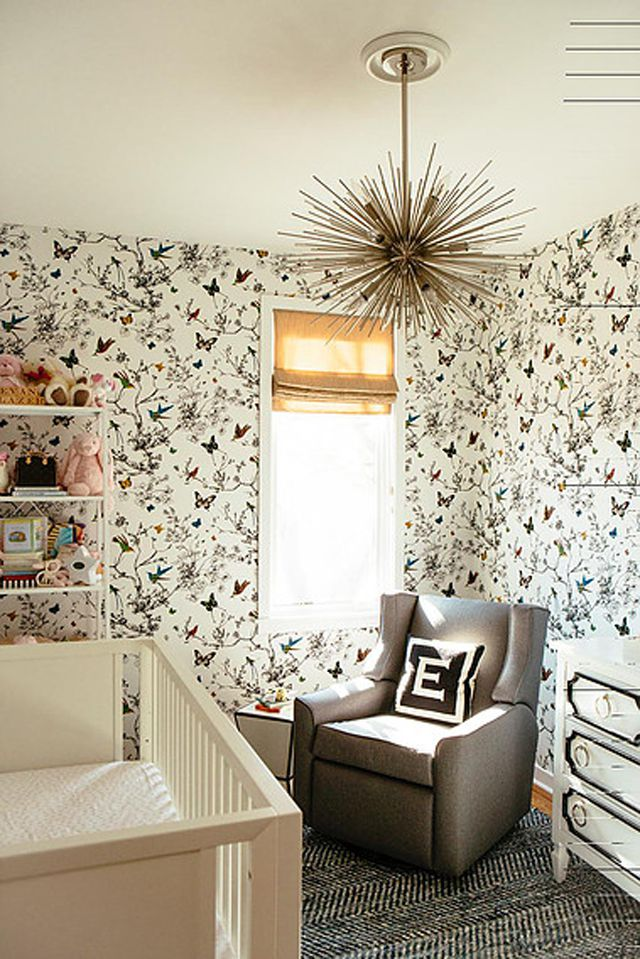 Modern nursery with French Country inspired wallpaper